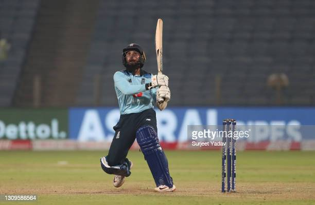 Adil Rashid of England plays a pull shot during the 3rd One Day International match between India and England at MCA Stadium on March 28, 2021 in...