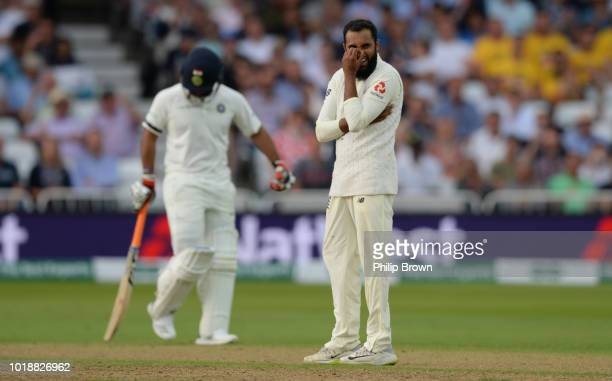 Adil Rashid of England reacts after being hit for a six by Rishabh Pant of India during the 3rd Specsavers Test Match between England and India at...
