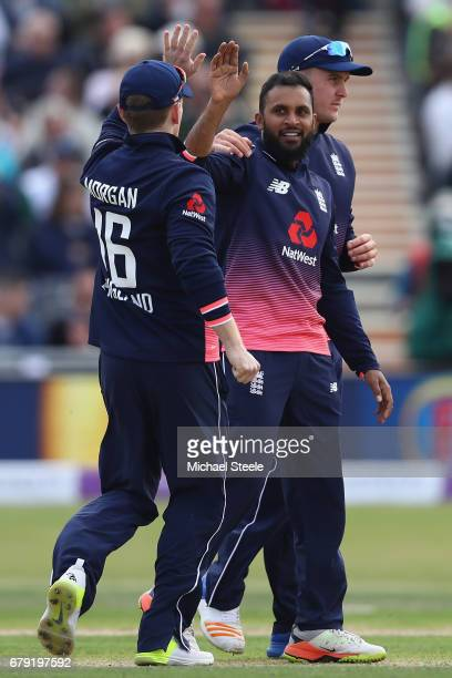 Adil Rashid of England receives captain Eoin Morgan's applause after capturing the wicket of Niall O'Brien of Ireland during the Royal London One Day...