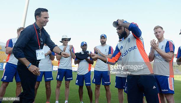 Adil Rashid of England receives his test cap from former captain Michael Vaughan ahead of the 1st Test between Pakistan and England at Zayed Cricket...