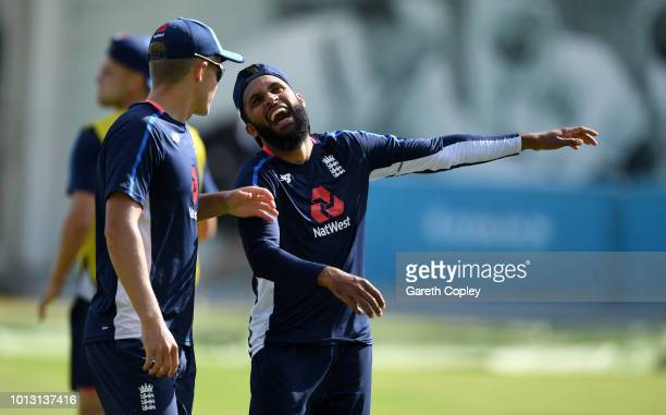 Adil Rashid of England shares a joke with Sam Curran during a nets session at Lord's Cricket Ground on August 8 2018 in London England
