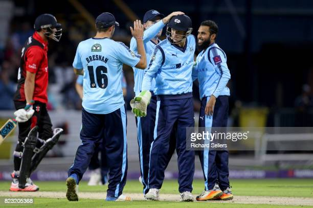 Adil Rashid of Yorkshire celebrates with Peter Handscomb of Yorkshire and Tim Bresnan of Yorkshire during the NatWest T20 blast between Yorkshire...