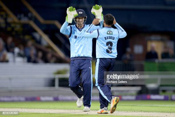 Adil Rashid of Yorkshire celebrates with Peter Handscomb of Yorkshire during the NatWest T20 blast between Yorkshire Vikings and Durham at Headingley...