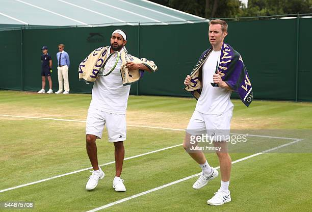 Adil Shamasdin of Canada and Jonathan Marray of Great Britain look on during the Men's Doubles first round match against Pablo Cuevas of Uraguay and...