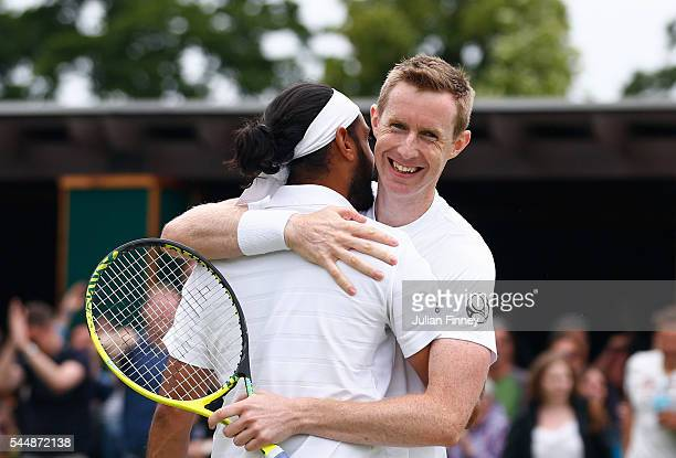 Adil Shamasdin of Canada and Jonathan Marray of Great Britain celebrates victory during the Men's Doubles first round match against Pablo Cuevas of...