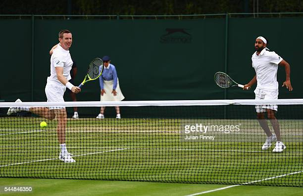Adil Shamasdin of Canade and Jonathan Marray of Great Britain in action during the Men's Doubles first round match against Pablo Cuevas of Uraguay...