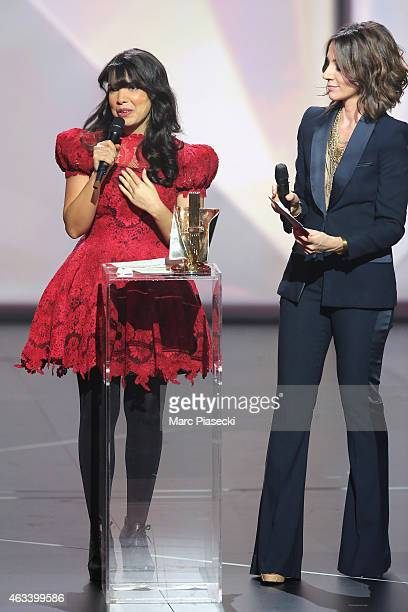 Adila Sedraia aka Indila receives from Virginie Guilhaume the revelation award for the album 'Mini World' during the 30th 'Victoires de la Musique'...