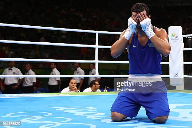 Adilbek Niyazymbetov of Kazakhstan reacts after being defeated by Julio Cesar La Cruz of Cuba in the Men's Light Heavy Gold Medal bout on Day 13 of...