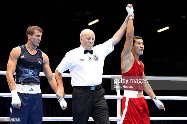 Adilbek Niyazymbetov of Kazakhstan reacts after he was declared the winner against Oleksandr Gvozdyk of Ukraine during their Men's Light Heavy Boxing...