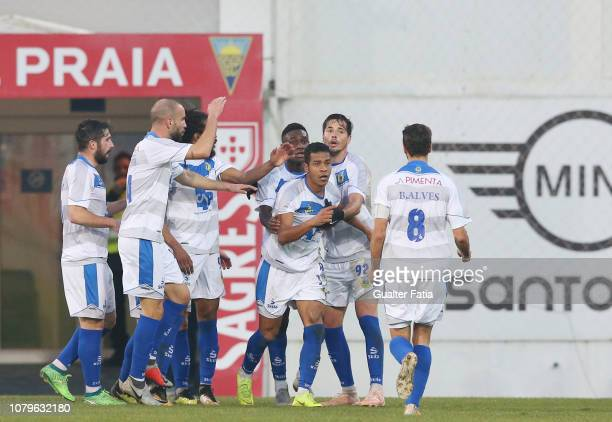 Adilio Santos of FC Arouca celebrates with teammates after scoring a goal during the Ledman Liga Pro match between GD Estoril Praia and FC Arouca at...