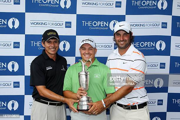 Adilson Da Silva of Brazil, Grant Veenstra of South Africa and Andrew Georgiou of South Africa pose with the Claret Jug after qualifying for The Open...