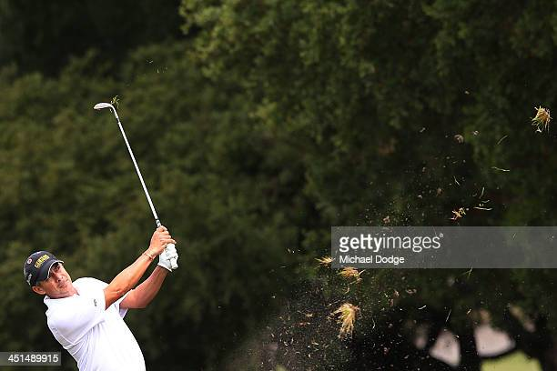 Adilson da Silva of Brazil hits an approach shot during day three of the World Cup of Golf at Royal Melbourne Golf Course on November 23, 2013 in...