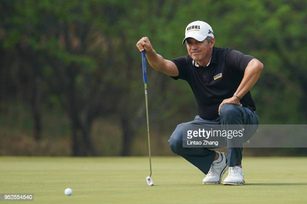 Adilson da Silva of Brazil lines up a putt on the 9th hole during the final round of the 2018 Volvo China Open at Topwin Golf and Country Club on...