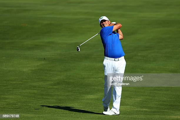 Adilson da Silva of Brazil plays a shot on the seventh hole during the final round of men's golf on Day 9 of the Rio 2016 Olympic Games at the...