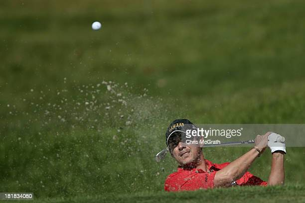 Adilson Da Silva of Brazil plays out of the bunker on the eighth green during day one of the Panasonic Japan Open at Ibaraki Golf Club on September...