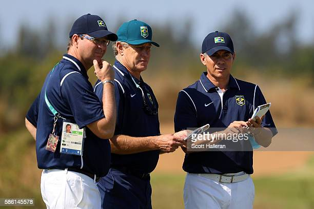 Adilson da Silva of Brazil talks with his caddy and coach during a practice round at the Olympic Golf Course prior to the Rio 2016 Olympic Games on...
