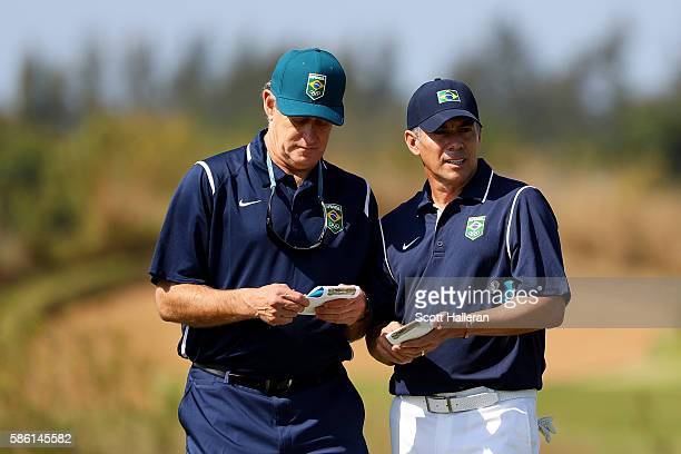 Adilson da Silva of Brazil talks with his caddy during a practice round at the Olympic Golf Course prior to the Rio 2016 Olympic Games on August 5...