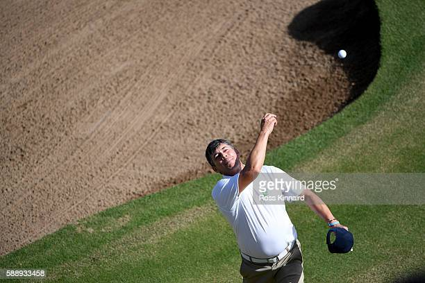 Adilson da Silva of Brazil throws his ball into the crowd on the 18th green during the second round of the Olympic Golf on Day 7 of the Rio 2016...