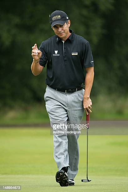 Adilson Da Silva of Brazil waves to the gallery during the second round of the 141st Open Championship at Royal Lytham St Annes Golf Club on July 20...