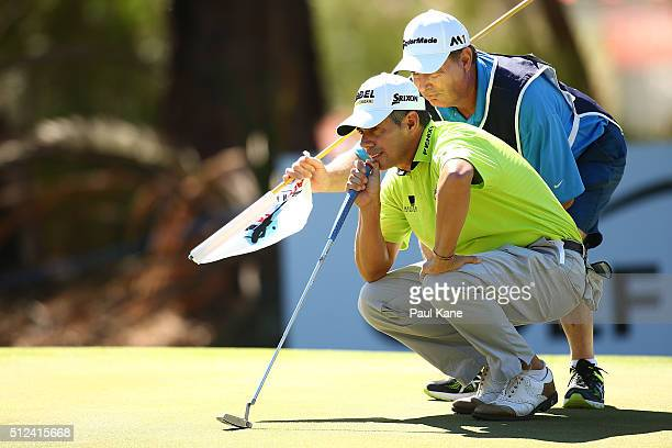 Adilson de Silva of Brazil reads the green on the 16th hole during day two of the 2016 Perth International at Karrinyup GC on February 26 2016 in...