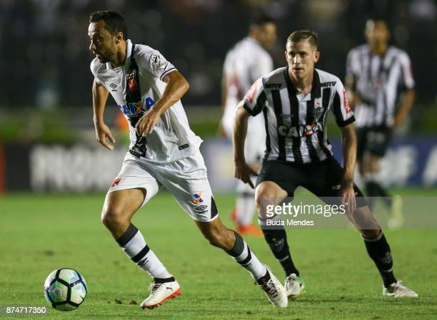 Adilson of Atletico MG fights for the ball with Nene of Vasco during a match between Vasco da Gama and Atletico MG as part of Brasileirao Series A...