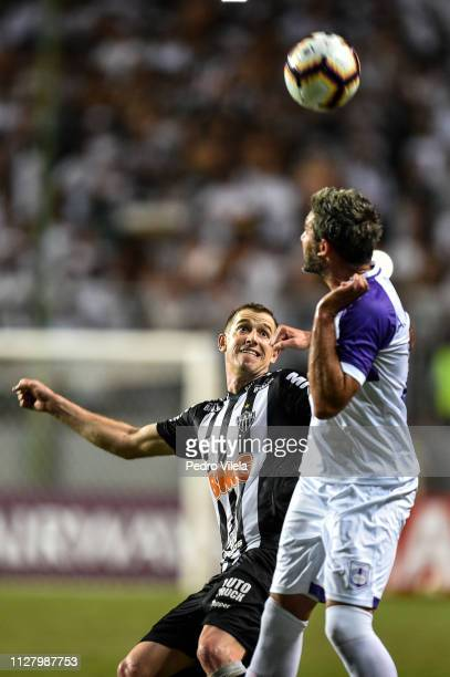 Adilson of Atletico MG struggles for the ball with Alvaro Navarro of Defensor during a match between Atletico MG and Defensor as part of Copa...