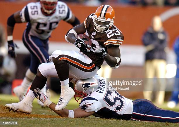Adimchinobe Echemandu of the Cleveland Browns is tackled by Mike Vrabel of the New England Patriots during the third quarter at Cleveland Browns...