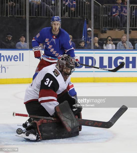 Adin Hill of the Arizona Coyotes makes the second period skate save as Kevin Hayes of the New York Rangers looks for a rebound at Madison Square...