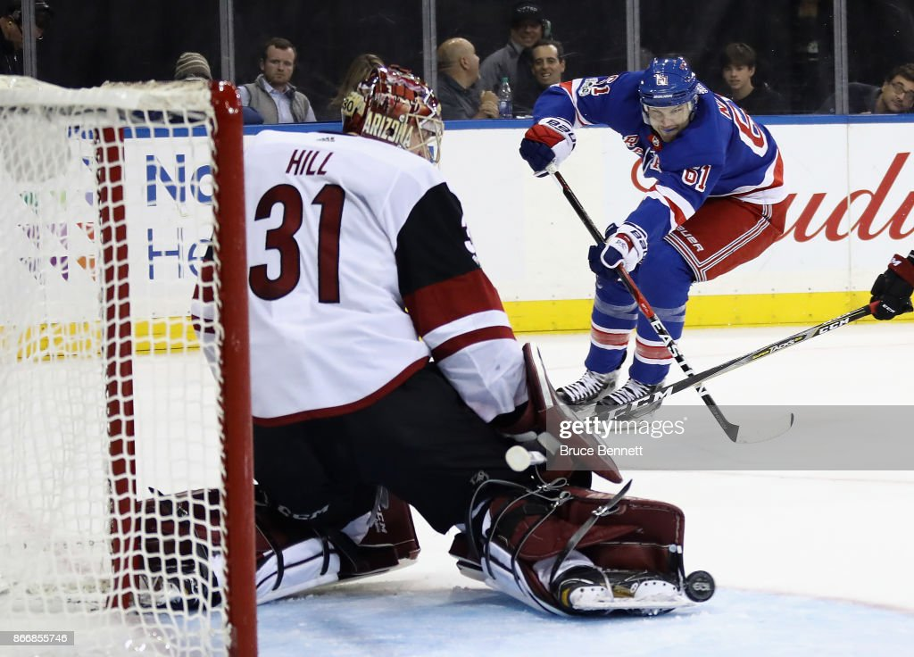 Adin Hill #31 of the Arizona Coyotes makes the toe save on Rick Nash #61 of the New York Rangers who was playing in his 1000th NHL game skates against the Arizona Coyotes at Madison Square Garden on October 26, 2017 in New York City. The Rangers defeated the Coyotes 5-2.