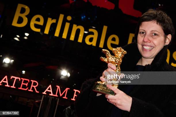 Adina Pintilie winner of the Golden Bear for Best Film for 'Touch Me Not' poses after the closing ceremony during the 68th Berlinale International...