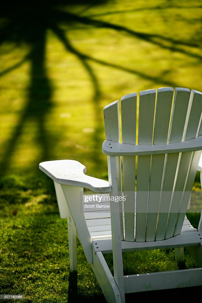 Adirondack chair in a sunny yard : Stock Photo