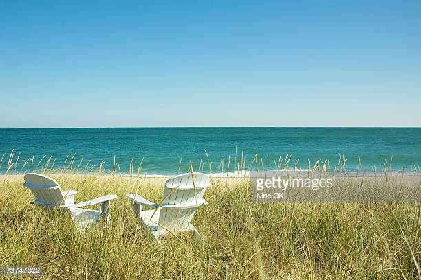 adirondack chairs in dunes at beach - massachusetts stock pictures, royalty-free photos & images