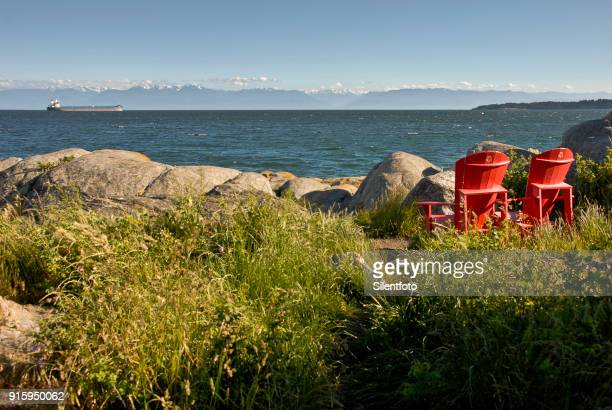 Adirondack Chairs Look Out Across Strait of Juan de Fuca to Olympic Mountain Range
