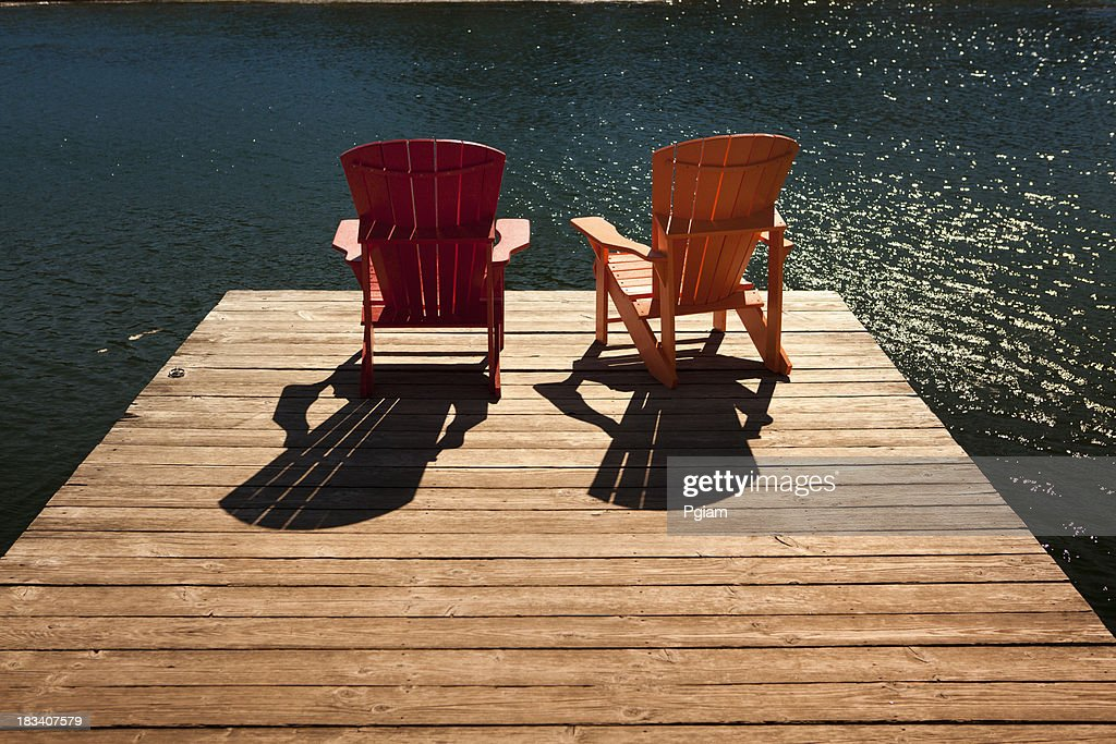 Rear View of Two Adirondack Chairs on a Dock, Minnesota