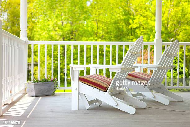 Adirondack chairs on a porch
