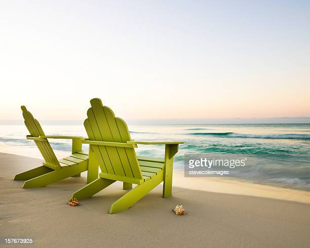 adirondack chairs on beach - outdoor chair stock pictures, royalty-free photos & images