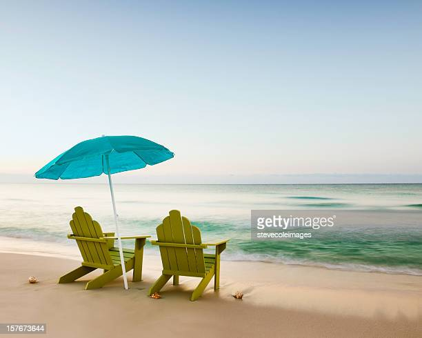 Adirondack Chairs on Beach with Unbrella