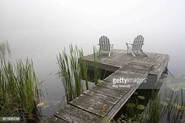 Adirondack Chairs on Pier in Fog