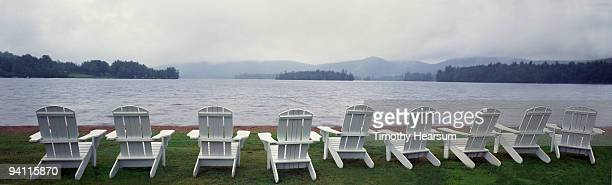 adirondack chairs overlooking lake, mountains  - timothy hearsum stock photos and pictures