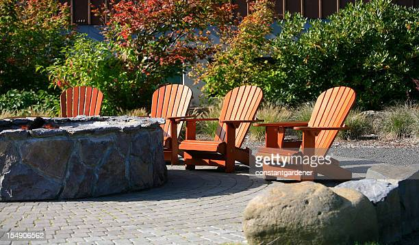 adirondacks around the fire pit - fire pit stock pictures, royalty-free photos & images
