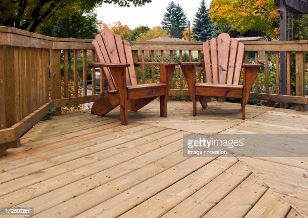 Adirondak chairs on backyard wood deck