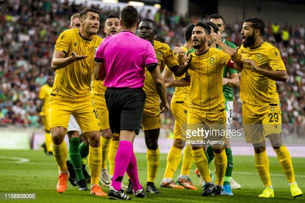Adis Jahovic and other players of Yeni Malatyaspor argue with the referee during UEFA Europa League 2nd Qualifying Round soccer match between Yeni...