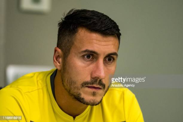 Adis Jahovic of Yeni Malatyaspor makes a speech during a press conference with Head coach Sergen Yalcin of Yeni Malatyaspor ahead of the UEFA Europa...