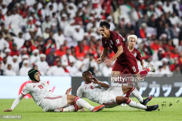 Adisak Kraisorn of Thailand competes with Ismail Ahmed Mohamed Ali Hassan Ali Salmin of United Arab Emirates during the AFC Asian Cup Group A match...