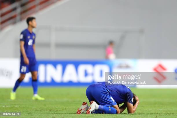 Adisak Kraisorn of Thailand reacts after the AFF Suzuki Cup semi final second leg match between Thailand and Malaysia at Rajamangala Stadium on...