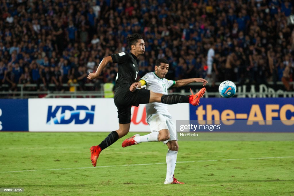 Adison Promrak (L) from Thailand vie for the ball during Taisir Al-Jassim (R) of Saudi Arabia during 2018 FIFA World Cup Qualifier Group B match between Thailand and Saudi Arabia at the Rajamangala National Stadium in Bangkok, Thailand, on March 23, 2017.