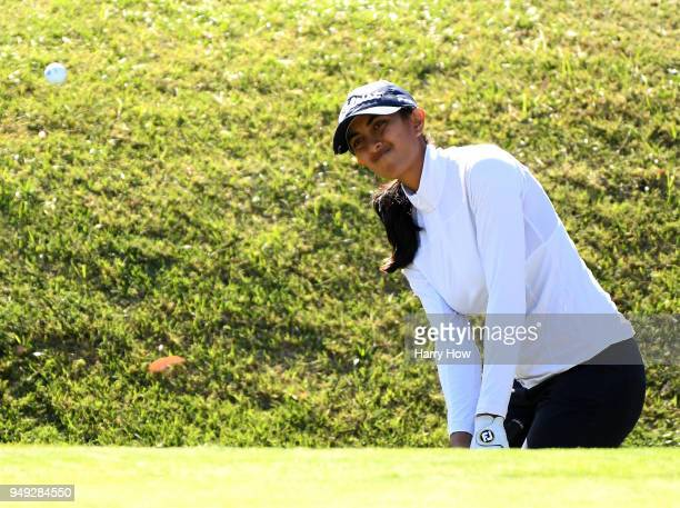 Aditi Ashok of India chips from the rough on the 18th green during round two of the HugelJTBC Championship at the Wilshire Country Club on April 20...