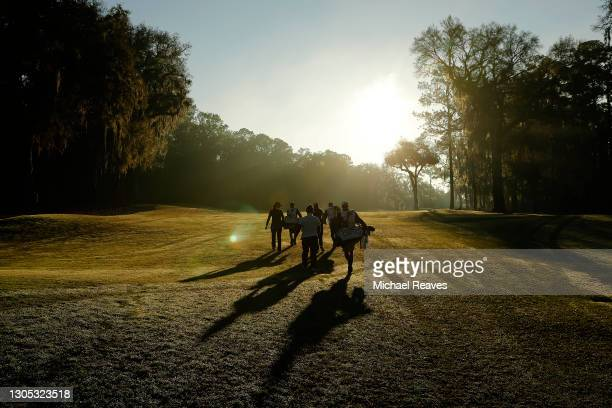 Aditi Ashok of India, In Gee Chun of Korea and Jane Park of the United States walk up the first fairway during the first round of the LPGA Drive On...