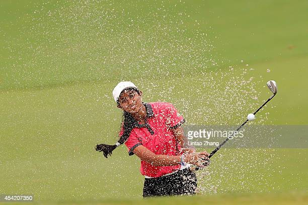 Aditi Ashok of India plays a shot during the Mixed Team on day ten of the Nanjing 2014 Summer Youth Olympic Games at at Zhongshan International Golf...