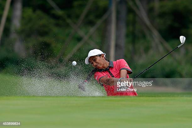 Aditi Ashok of India plays a shot during the Women's Individual Stroke Play on day five of the Nanjing 2014 Summer Youth Olympic Games at Zhongshan...